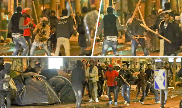 Armed migrants fight running battles in the French capital